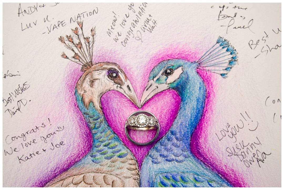 peacocks and wedding rings