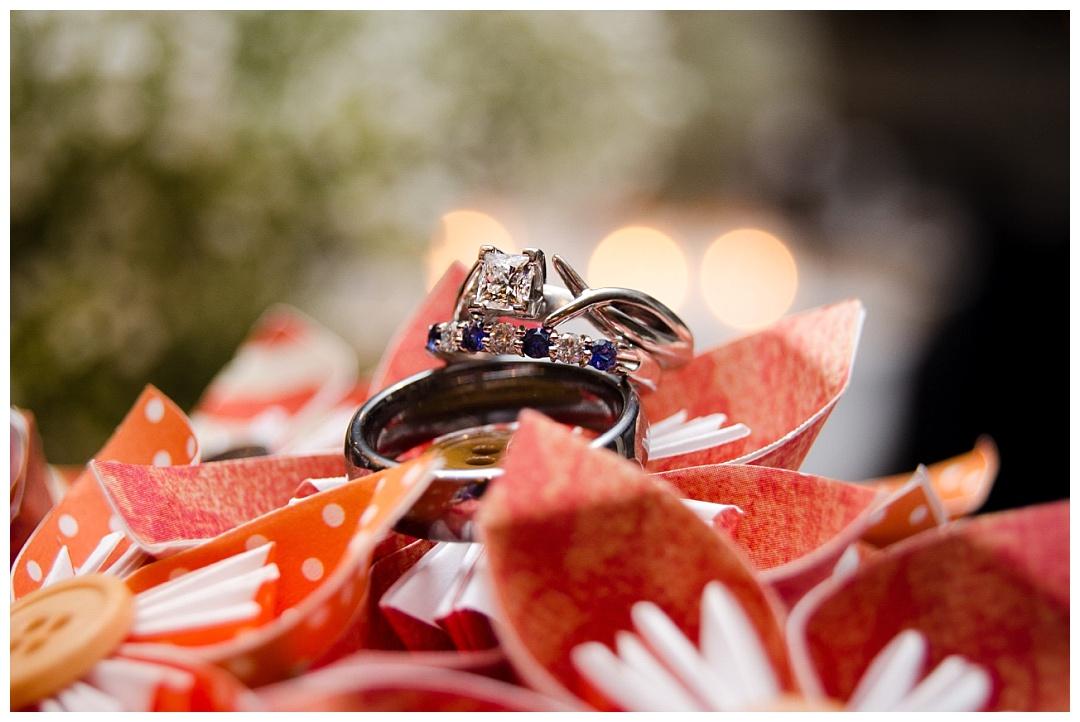 wedding rings on paper flowers