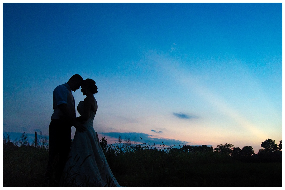 bride and groom blue sunset silhouette